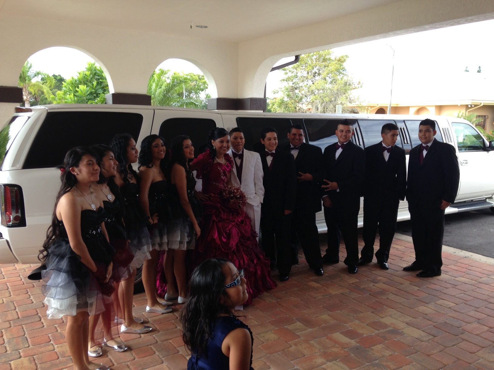 Quinceanera Group poses with Escalade Limo