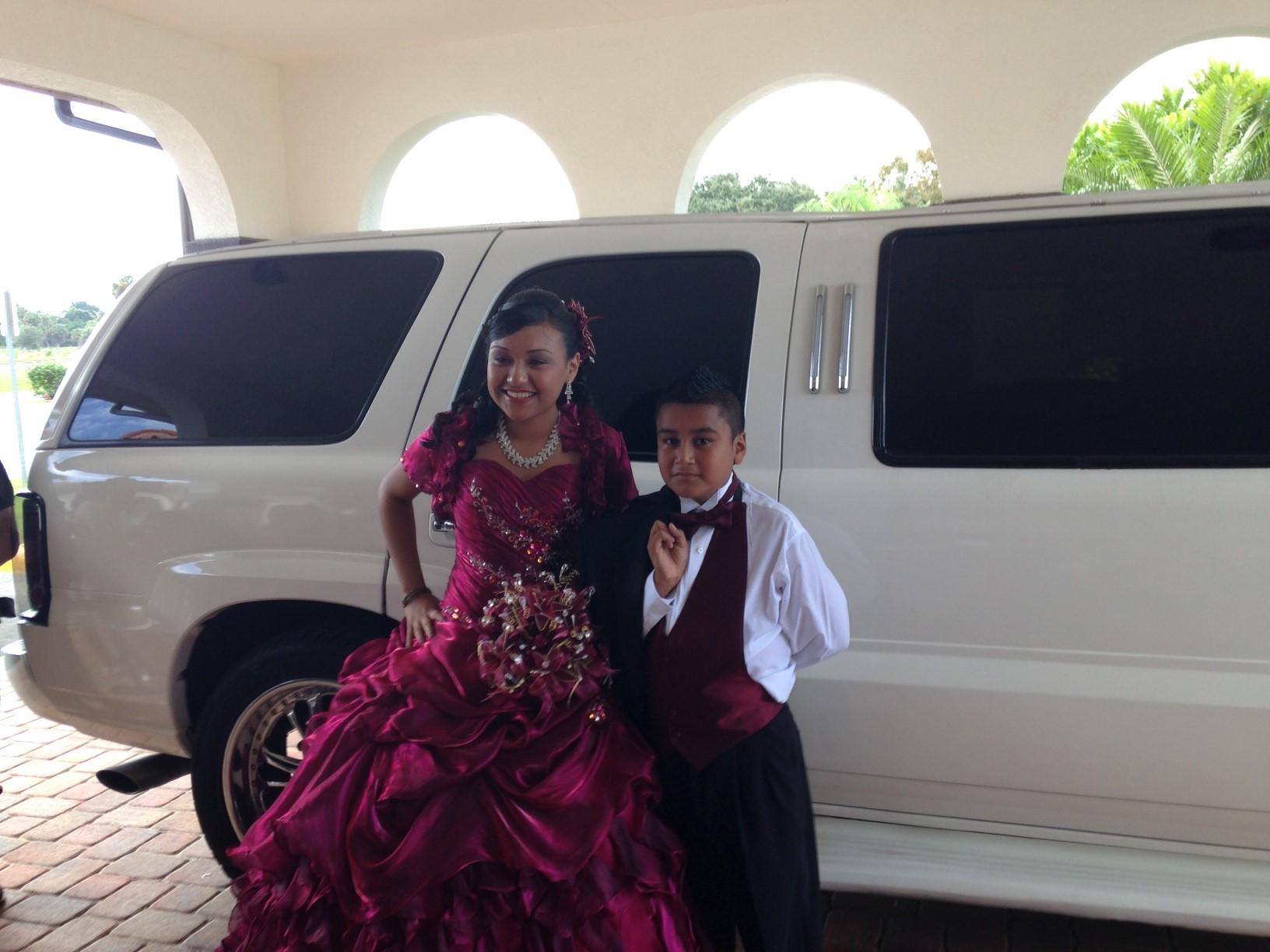 Quinceanera Poses next to Caddy Limo